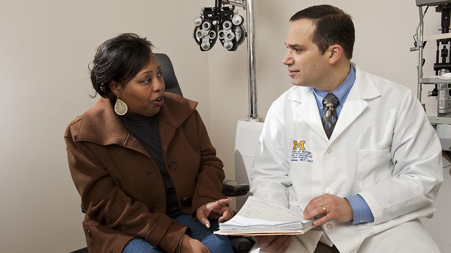 Dr. Alon Kahana with a patient
