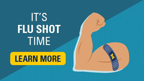 Flexed arm with a bandaid. Text reads: It's flu shot time