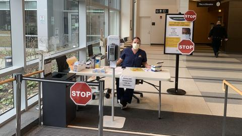 Screening station at entrance to Kellogg Eye Center